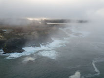 Fog-Covered, Rocky Shoreline in Northern California Royalty Free Stock Image