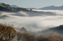 Fog covered valley in Basque country side Royalty Free Stock Photo