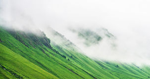 Fog covering mountain slope Royalty Free Stock Photography