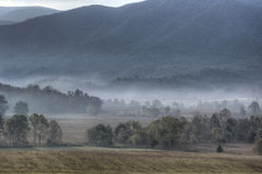 Fog covers the fields of Cades Cove Royalty Free Stock Photography