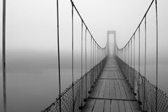 Fog created on a bridge. Walking inside fog, people are suddenly confronted with white darkness in a cold winter daynnPhoto was taken in a small village of royalty free stock image
