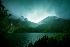 Fog and dark clouds in mountains. Lake in mountains Royalty Free Stock Image