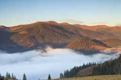 Fog at dawn in the mountains Stock Photo