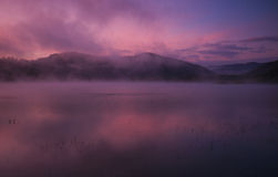 Fog at dawn over Lake Solina in the Bieszczady Stock Image