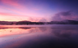 Fog at dawn over Lake Solina in the Bieszczady. Mountains stock image