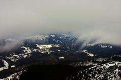 Fog descending over the valley Stock Photos