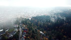 Fog dissipates to reveal Portland. This is a footage of fog dissipates to reveal Portland in autumn colors stock video footage