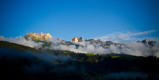 Fog in Dolomites mountains, Italy royalty free stock photos