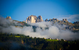 Fog in Dolomites mountains, Italy. Panoramic view with fog shrouds fur-trees in the Val di Fassa wood, Dolomites mountains (Alps), Italy Stock Photos