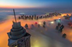 Fog in dubai. Aerial view of city from dubai marina during foggy weather Stock Photos