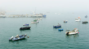 Fog at the fishing port at Cascais, Portugal Royalty Free Stock Images