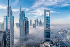 Fog in Futuristic City of Dubai. 26th December 2018 - Dubai, UAE. Futuristic megacity with modern towers covered in mist. Foggy morning in Dubai financial royalty free stock photography