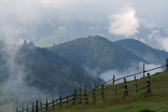 Fog on the green slopes of the mountains in the Carpathians royalty free stock images