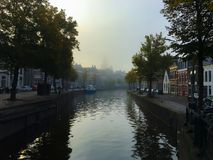 Fog in Groningen. A beautiful shot of a foggy serene Groningen canal in the morning Stock Photos