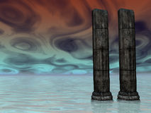 Fog Guardians. Two ancient pillars guarding the foggy unknown Royalty Free Stock Image