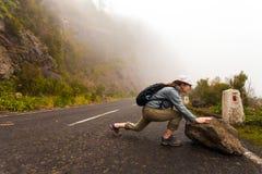 Road Fog Rock. Road Lady pushing Rock Fog Royalty Free Stock Photos