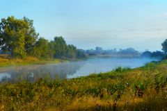 Fog or haze over the lake on a summer morning. Beautiful countryside stock photography