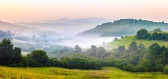 Fog on hillside in rural area Stock Image