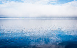 Fog on horizon, rising off the Ottawa River. Stock Images