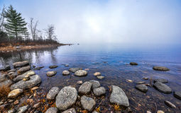 Fog on horizon, rising off the Ottawa River. Royalty Free Stock Photos