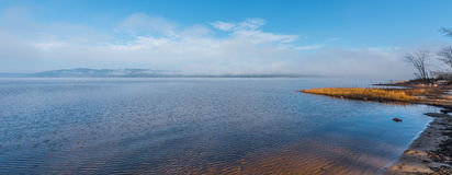 Fog on horizon, rising off the Ottawa River.  Laurentian hills in background. Stock Photography