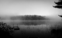 Fog on the lake. (B&W) Royalty Free Stock Images
