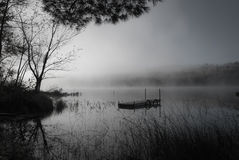 Fog on the lake in black and white. Royalty Free Stock Image