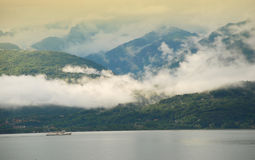 Fog on Lake Maggiore. Low clouds on Lake Maggiore shore, Italy, at sunrise royalty free stock image