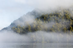 Fog on the Lake in the morning Stock Images