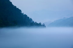 Fog and lake and  mountain Stock Images