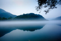 Fog and lake and  mountain. Fog and lake  in the morning Royalty Free Stock Images