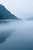 Fog and lake and  mountain in morning Royalty Free Stock Photos