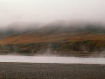 Fog lifts on the Horton River Stock Image