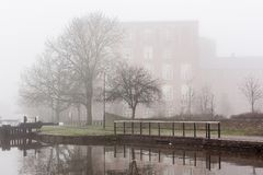 Misty Canal near Wigan Pier. The fog and the mist over the Leeds Liverpool canal near Wigan Royalty Free Stock Images