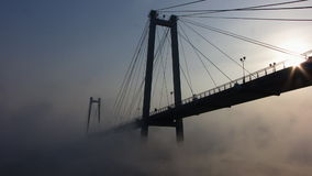 Fog and mist on river. Bridge. Fog and mist moves across the river stock video footage
