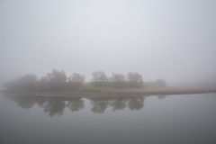 Fog and mist on a wild river Stock Photography