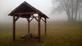Fog at Morava - Beskydy. Small seating area with forest background Stock Photography