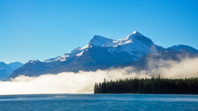 Fog in the morning at Lake Maligne Stock Photos