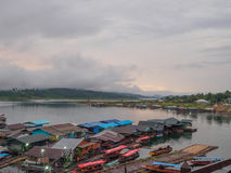 Fog,morning light a view from from the bridge. the Sagklaburi,Kanchanaburi. royalty free stock image