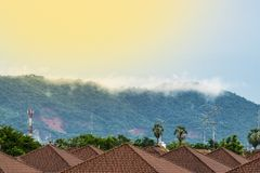 Fog on the mountain behind the house Royalty Free Stock Photos