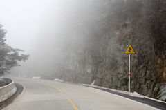 Fog on the mountain road Stock Photography