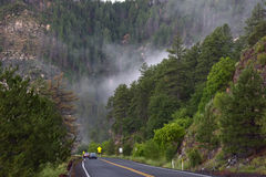 Fog on the mountain road Stock Photo