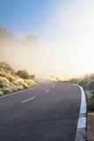 Fog on the mountain road Stock Image