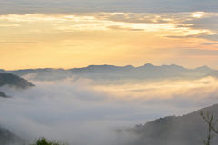 Fog Mountain and sunrise Royalty Free Stock Photos
