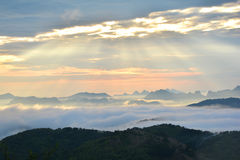 Fog Mountain and sunrise Stock Photography