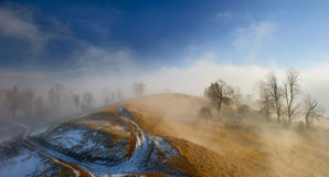 Fog in mountain village Royalty Free Stock Photo
