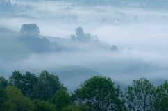 Fog in the mountain village Royalty Free Stock Photography