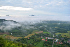 Fog Mountain and village Stock Photography
