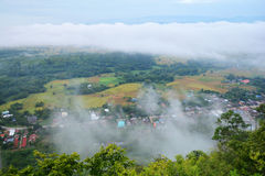 Fog Mountain and village Royalty Free Stock Photography