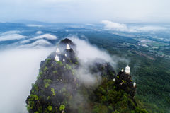 Fog on the Mountain.Wat Mongkut Memorial Rachanusorn a public te. Mple on the hill. The wonderful thing is beautiful. It is located in Lampang, Thailand Royalty Free Stock Photos